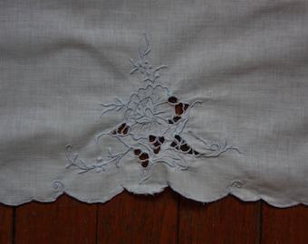 White Guest/Hand Towel with Blue Embroidery and Cutouts.