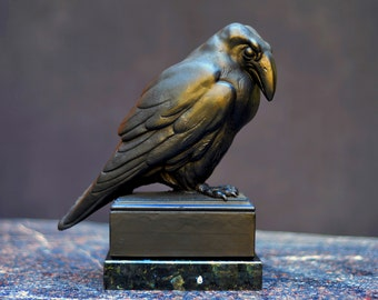 Bronze sculpture, RAVEN, with black patina on a plinth of black granit