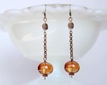 Copper and orange glass bead dangle earrings on wire hooks