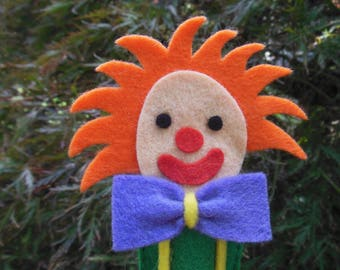 Finger puppets: red haired clown.