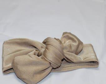 Bandeau bébé en tissu stretch beige