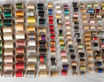 178 Spools of thread wood spools 90% with thread