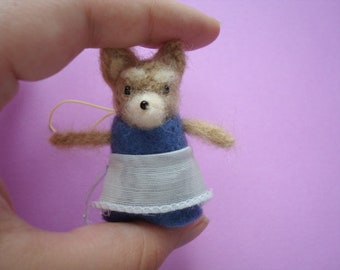 Needle felted miniature coyote wearing an apron plush keychain