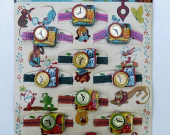 12 Vintage Japanese Toy Watches on Display Card