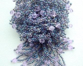 Brooch of beads and crystals