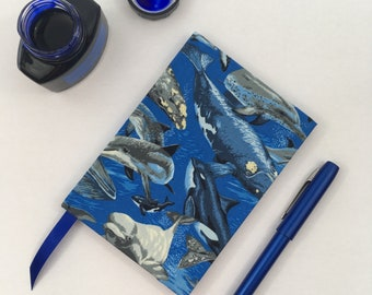 Recycled A6 Lined Notebook hand covered in a stunning Whales and Dolphin Ocean Themed Fabric