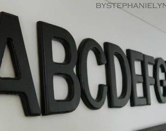 White & black wooden letters
