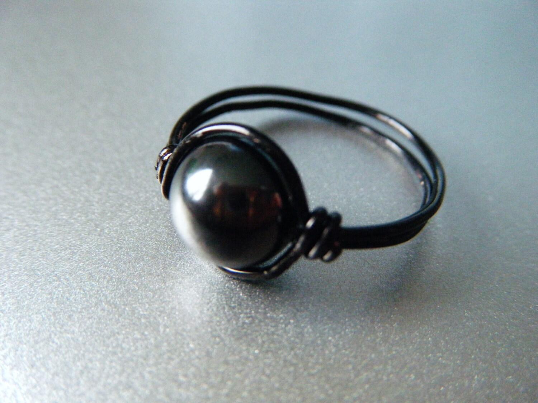 Hämatit Ring Wurzel-Chakra schwarzer Draht gewickelt Ring