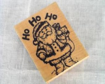 """Santa Claus saying """"Ho Ho Ho"""" with bag of toys - Rubber Stamp 2"""" Inches - Good used condition - some ink stains"""