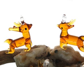 Reindeer in brown glass, 28 x 26 x 10 mm, hole: 5 mm, lampwork pendant.