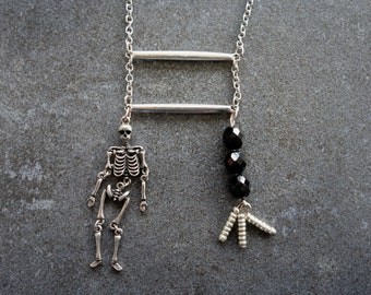 Skeleton and black and silver beads necklace