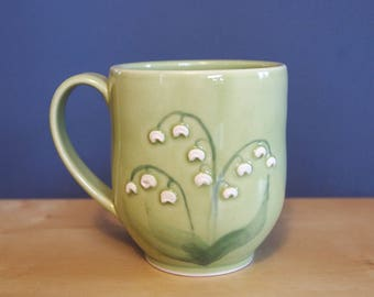 mug with lily of the valley flowers