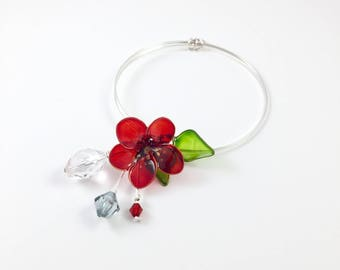 Silver bangle with red flower