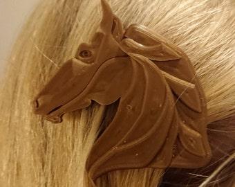 Horse barrette, a pair.