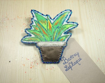 Small green plant brooch
