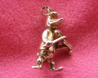 D) Vintage Sterling Silver Charm Woody Woodpecker playing the violin