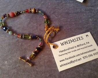 Glass beaded bracelet, size MEDIUM, earthtone, goldtone. Boho, hippie, fair trade, gift, free shipping. Made in USA.