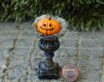 Miniature pumpkin. For a miniature garden a vase with a pumpkin. For a holiday on Halloween. Scale 1/12.