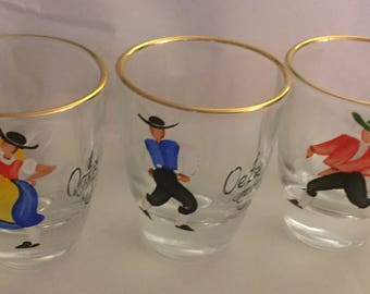 A set of three jolly vintage hand painted shot glasses from the Tyrol.
