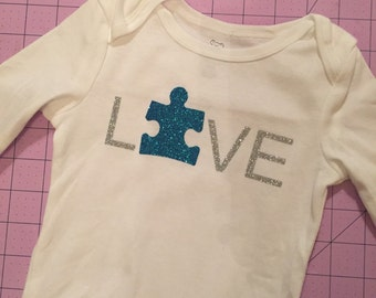 Baby autism awareness bodysuit.