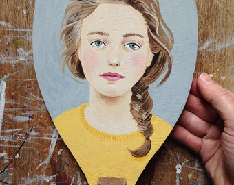 Hand painted vintage table tennis bat - a girl wearing yellow on a grey background