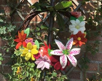 Needle felted flower wreath decoration.