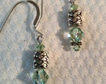 Chrysolite Swarovski and Sterling silver pierced earrings with Celtic knot beads.