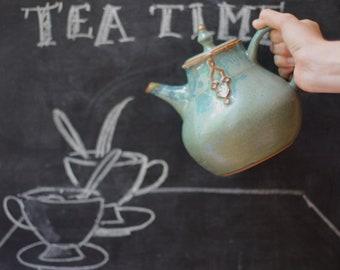 Handmade green stoneware teapot