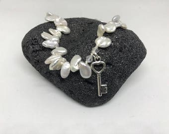 Personalize your freshwater Keshi Pearl Necklace with the charm of your choice