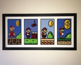 8bit Inspired, 'Evolution of Mario' from Super Mario Bros 1 thru Super Mario World, Cross Stitched in Custom Framing