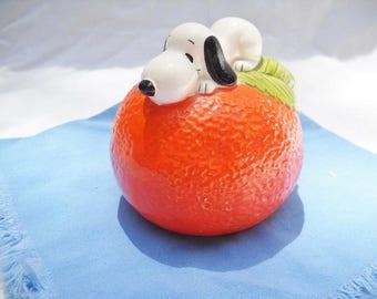 Vintage Snoopy Bank on an Orange