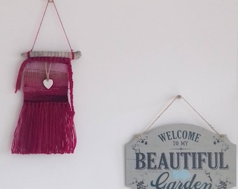 Pink and magenta woven wall hanging