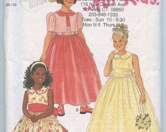 New Look 6737 Girls Dress with Overskirt and Bolero Children's Sewing Pattern Size 4 - 9 UNCUT