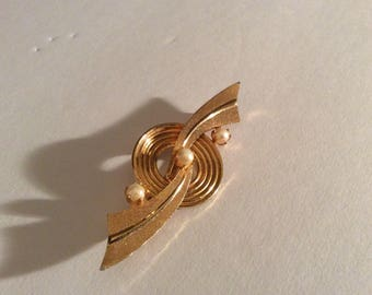 Triad Gold Tone Brooch
