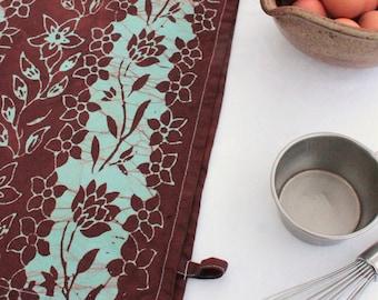 rust red and aqua blue tea towel pattern