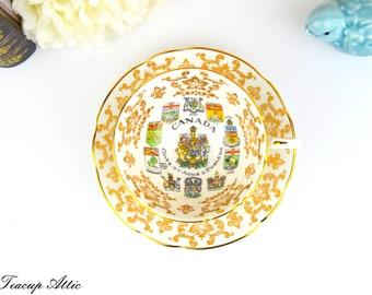Paragon Canadian Provincial Emblems Teacup and Saucer Set, Coat of Arms and Emblems English Bone China, ca. 1953