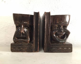 On Quirky Sunday we bring you a pair of comedy and tragedy bookends of carved wood to make U :) or wonder...
