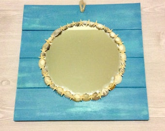 Mirror on hanging wooden base with mini sea shell and star fish detail