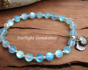 Blue Lagoon - Aqua Mystic Aura Gemstone Bracelet with Sterling Silver Spacers & Alloy Metal Clam shell Charms