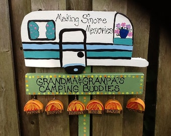 Grandparent camping sign with hanging grandchildren