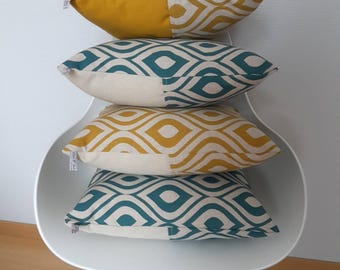 Geometric patterned pillow cover in mustard yellow and green on light taupe background