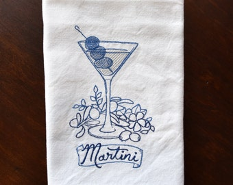 Martini embroidered kitchen, dish, and tea towel with two bold blue side stripes and hanging loop