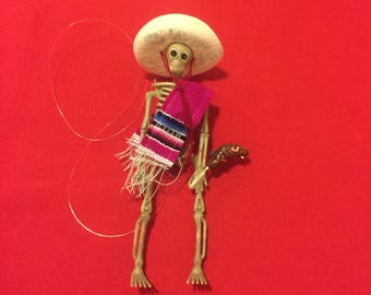 Pink Sarape day of the dead skeleton ornament with a chocolate banana #13