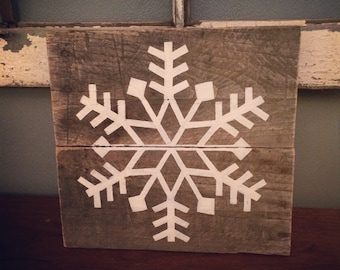 Reclaimed wood snowflake, perfect for holiday decorating!
