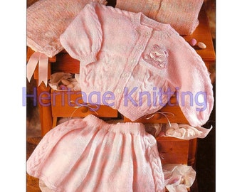 baby / girl cardigan and skirt dk knitting pattern 99p