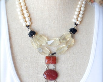How to wear WOW! ..... Freshwater pearls, yellow citrine and brown carved carnelian.  A beautiful strand of nature on your very own neck.