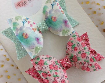 Floral patterned dolly hair bows with chunky glitter.