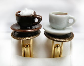 black coffee and cream topping on golden tablett, cufflinks