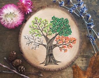 Four seasons tree on wood slice. Winter, spring, summer and autumn. Seasonal tree wood slice small wall hanging.