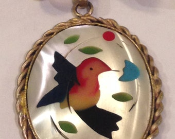 vintage native american zuni brass frame brooch inlay mother of pearl inlay with coral and turquoise. circa 1960.